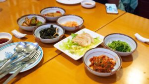 Banchan with Cabbage Kimchi (lower right) and Mandu Dumplings at Koreana Restaurant