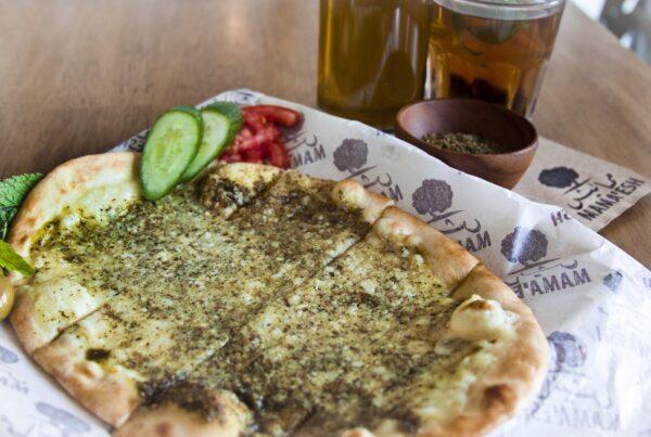 Palestinian za'atar and cheese manousheh in Dubai at Mama'esh